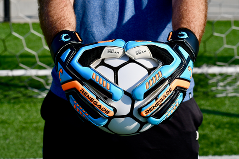 goalkeeper wearing talon cyclone 2 holding ball with 2 hands