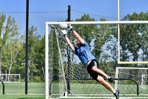 goalkeeper wearing renegade talon cyclone 2 jumping towards the ball to catch it