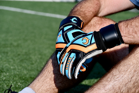 goalkeeper with Renegade GK Talon Cyclone 2 sitting on the grass