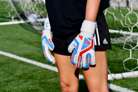 goalkeeper with renegade gk talon mirage gloves gurading the posts
