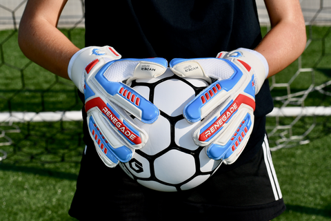 goalkeeper wearing talon mirage gloves holding the ball with 2 hands
