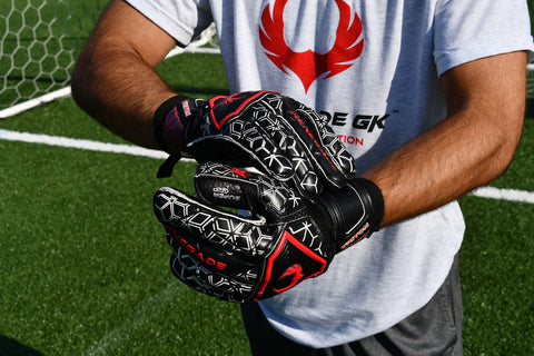 Soccer Goalie adjusting the Straps of Triton Frenzy Goalkeeper Gloves
