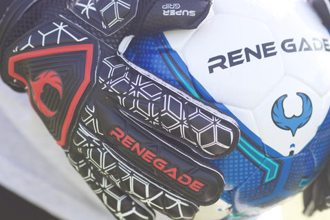 Goalkeeper holding the ball with Triton Frenzy Gloves