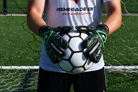 goalkeeper wearing triton raider holding ball with 2 hands