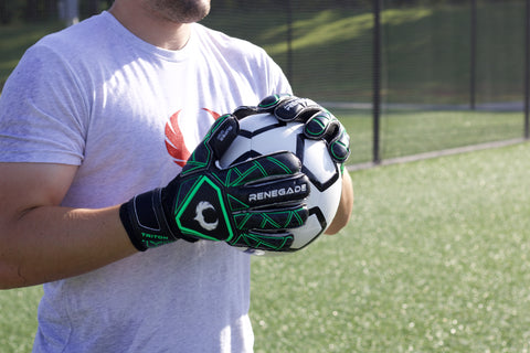 soccer goalkeeper holding ball with triton raider gloves