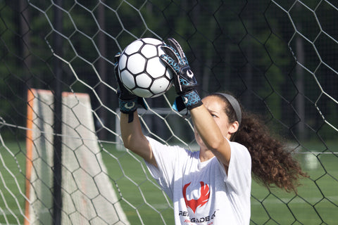 girl goalie using triton specter catching the ball from above