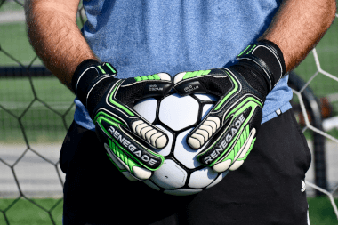 Renegade GK Vulcan Abyss Goalkeeper Gloves Boy Holding the Ball
