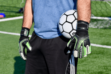Renegade GK Vulcan Abyss GK Gloves Holding Ball on the Side