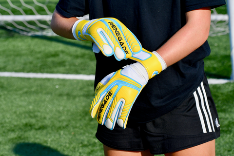 goalkeeper adjusting the straps of vulcan surge gloves