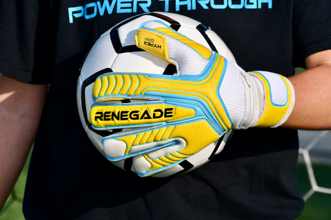 soccer goalkeeper using vulcan surge holding the ball with 1 hand
