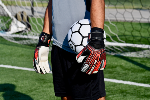 goalkeeper wearing vulcan torch holding the ball on the side