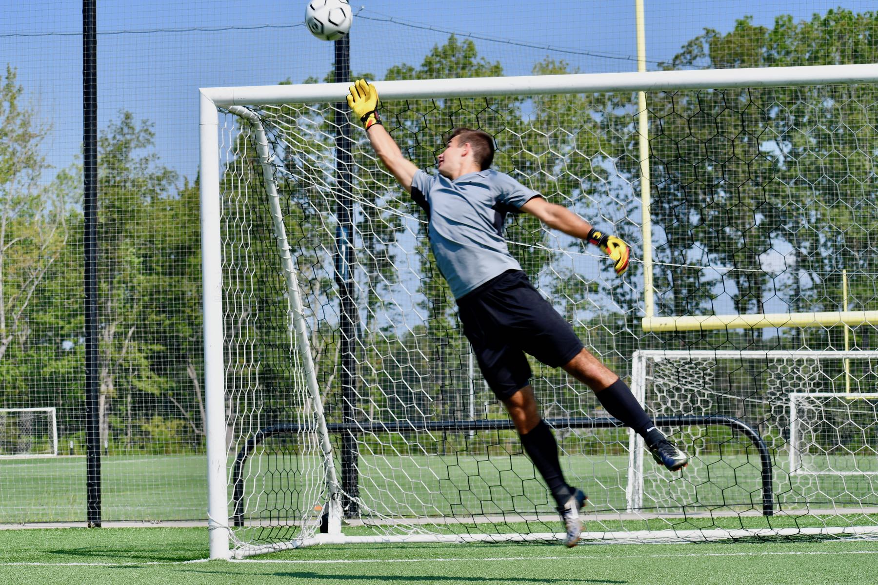 goalkeeper jumping to catch the ball