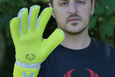 goalkeeper with vulcan surge gloves shows palm side