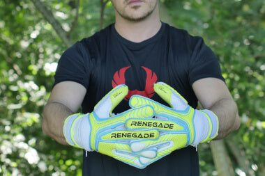 goalkeeper with vulcan surge gloves stretching arms