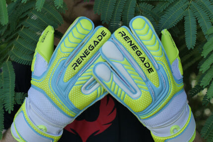 goalkeeper with vulcan surge gloves under the tree