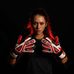female goalkeeper wearing fury inferno goalie gloves