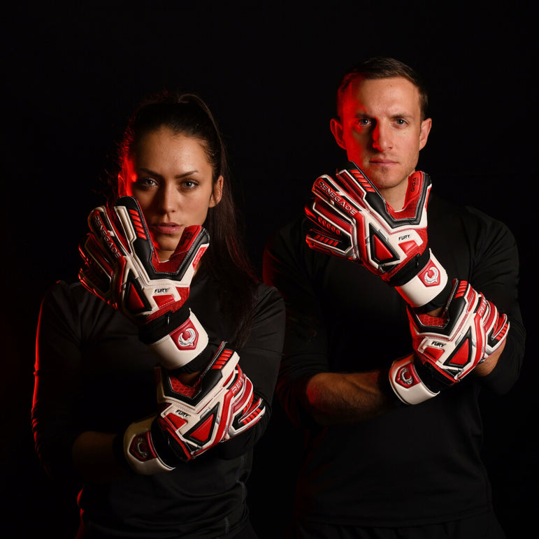 male and female goalkeeper wearing fury inferno keeper gloves