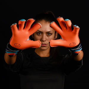 female goalkeeper wearing fury siege goalie gloves