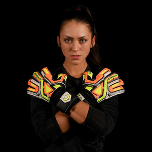 female goalkeeper wearing fury volt goalie gloves