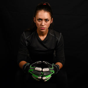 female goalkeeper wearing vulcan abyss keeper gloves