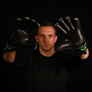 male goalkeeper wearing vulcan abyss goalie gloves