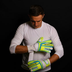 male goalkeeper wearing vulcan surge goalie gloves adjusting straps