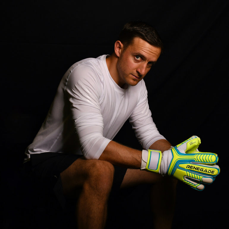 male goalkeeper wearing vulcan surge gk gloves