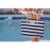 Woman holding Blue and White Stripped PortoVino Canvas Beach Purse