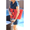 Woman pouring wine from red PortoVino Wine Purse