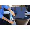 Woman pouring wine from blue PortoVino Wine Purse