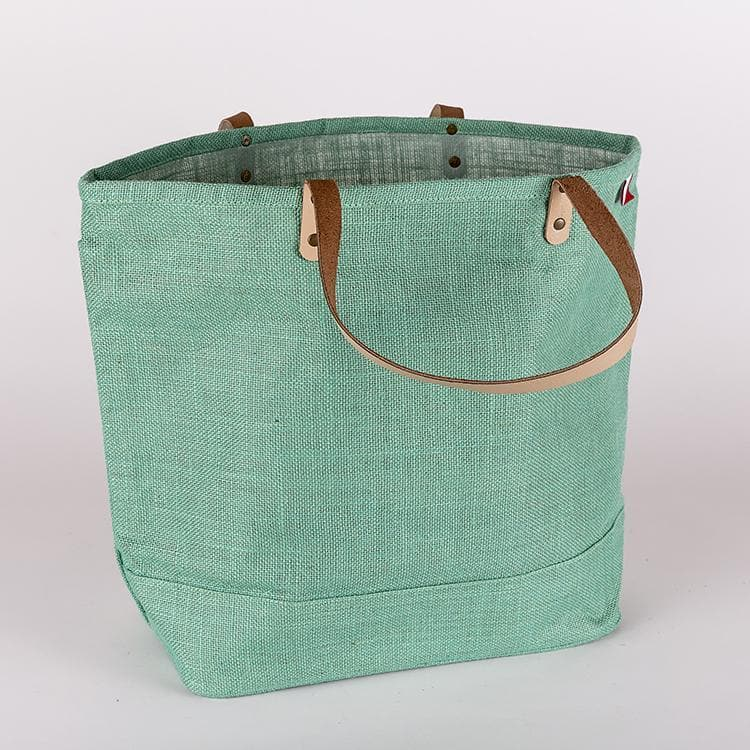 """Big Jute Bag from ShoreBags. Made with all-natural jute that's vegetable-dyed in bright colors, this bag has leather handles and a laminated interior."""