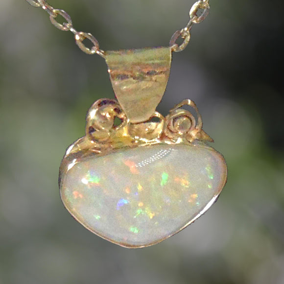 WHITE OPAL  set in 18ct Gold Pendant