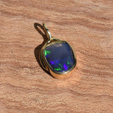 CRYSTAL OPAL IN 18CT GOLD PENDANT