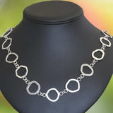NECKLACE OF FLAT Eccentric Argentium Silver Rings