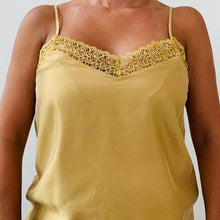 BLUSA CURRENT AMARILLA METALICA...