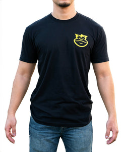 Photo of a man wearing a black t-shirt with a gorilla logo in the top-left chest area.