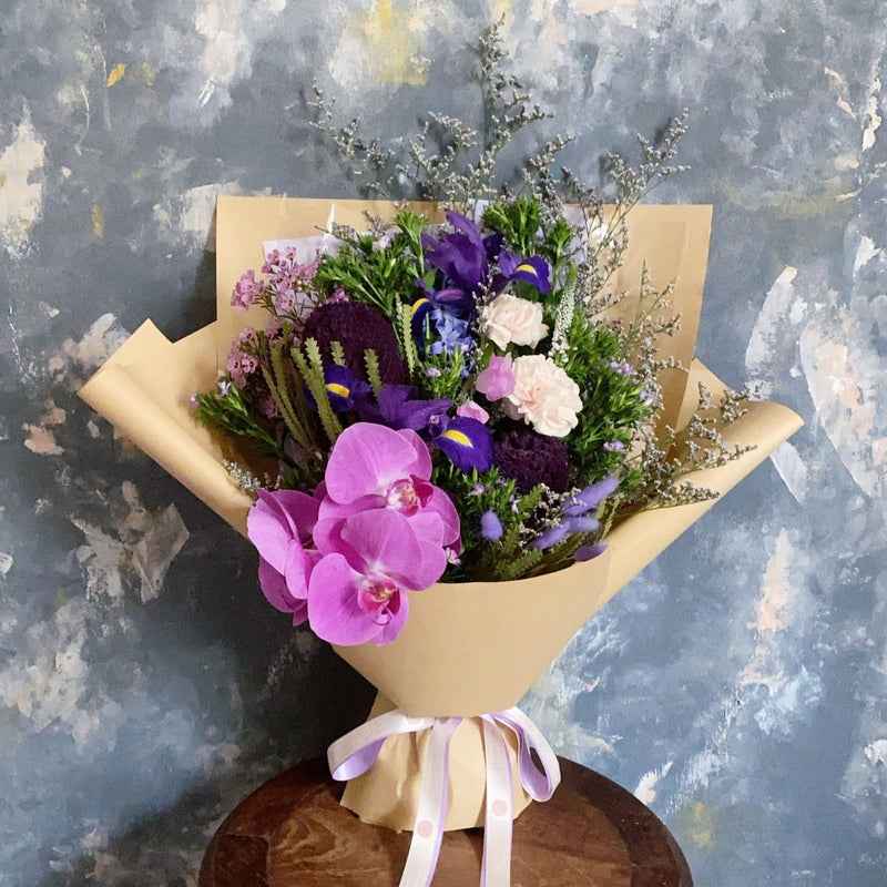 Potpurri - Featuring a single phalaenopsis orchid with an unlikely mix of iris, banksias and rabbit tails - Orchid with mixed flowers bouquet - Flourish by Charlene