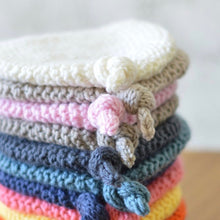 100% merino wool baby beanies, hand knitted in Melbourne.  Cold gentle wash in approved wool detergent