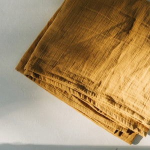 Beautiful, soft, light organic cotton muslin wraps in earthy colours by TANINAKA. Mustard