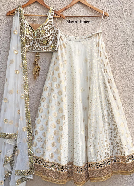Antique Gold Blouse and Burnt Orange Mirror work Lehenga Set