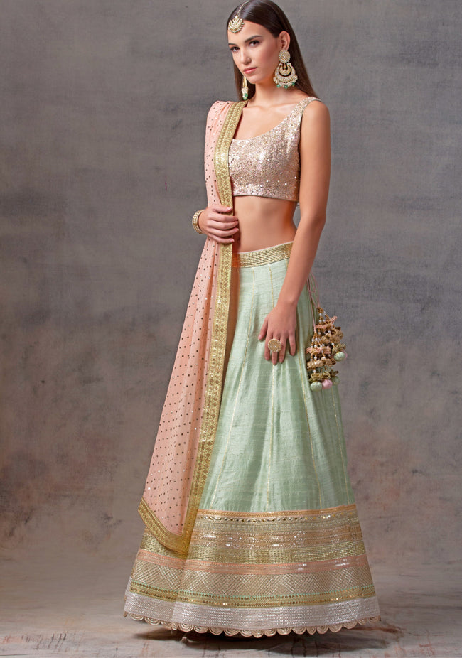 Mint Green Raw Silk Lehenga with Peach Sequence Blouse and Peach Dupatta Lehenga Avnni Kapur