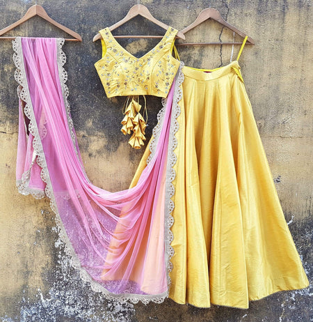 Yellow One Shoulder Blouse In Organza Teamed With Peach Skirt