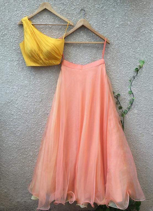 Yellow One Shoulder Blouse In Organza Teamed With Peach Skirt Lehenga Shrena Hirawat