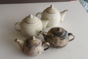 stoneware high-fired teapots, milky white and white/black matte glazes