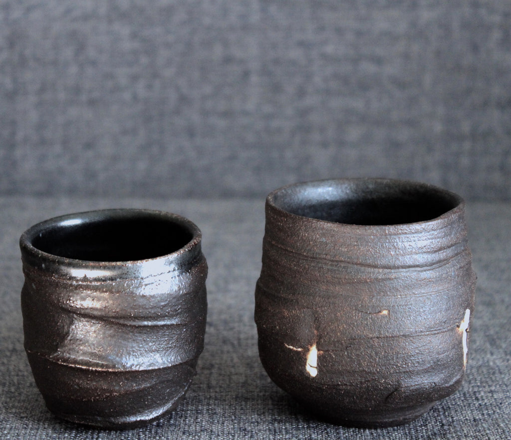 Small black clay cups with engobe
