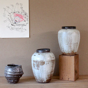 high-fired stoneware vases, white slip, carved
