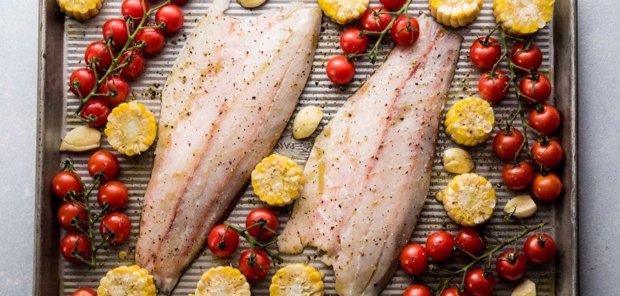 Sheet Pan Roasted Barramundi with Corn, Tomatoes, and Lime Butter