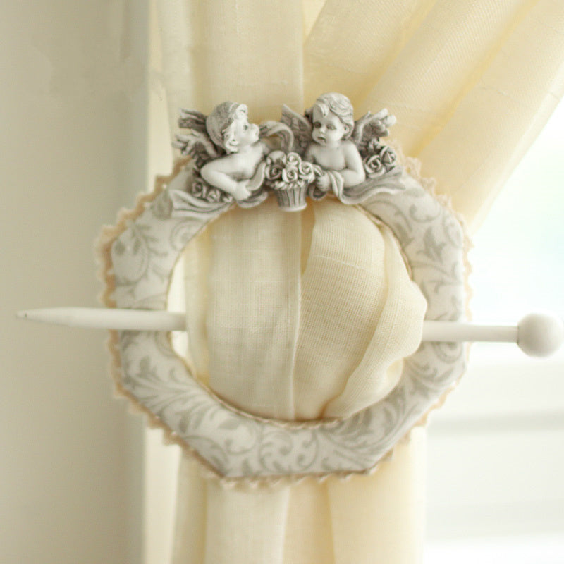 https://cdn.shopify.com/s/files/1/2617/5186/products/Europe-Creative-lace-curtains-holder-clip-hook-Cute-Angel-Baby-Window-Curtain-Tieback-Buckle-home-decor.jpg?v=1521114328