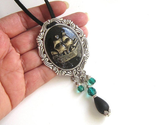 silver vintage ship necklace with green accents