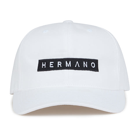 White Hermano Logo Embroidered Snapback Cap - H E R M A N O